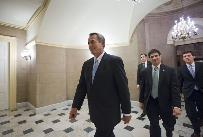 ** FILE ** House Speaker John A. Boehner, Ohio Republican, walks on Tuesday, Jan. 15, 2013, to the chamber at the Capitol in Washington for the final vote as the House of Representatives passed a $50.7 billion emergency aid bill for states hit by Superstorm Sandy. (Associated Press)