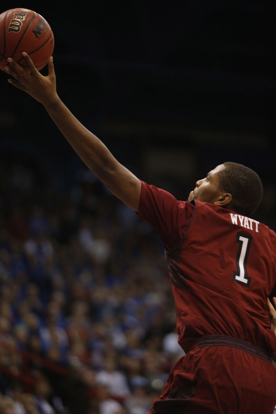 Temple guard Khalif Wyatt (1) during the second half of an NCAA college basketball game against the Kansas in Lawrence, Kan., Sunday, Jan. 6, 2013. Kansas defeated Temple 69-62. (AP Photo/Orlin Wagner)