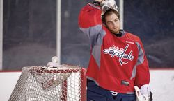 Capitals goaltender Braden Holtby recorded a 1.95 goals against average and a .935 save percentage in 14 playoff games last year. The 23-year-old is competing with Michal Neuvirth for the starting spot to open the lockout-shortened 48-game regular season. (Andrew Harnik/The Washington Times)