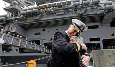 Rear Adm. Craig Faller, commander of the John C. Stennis Strike Group, is welcomed home by his wife, Martha, as the USS Stennis returned to Bremerton, Wash., in March. The stay was shortened from December to August. (Associated Press)