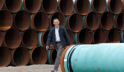 ** FILE ** President Obama visits the TransCanada Stillwater Pipe Yard in Cushing, Okla., in March 2012. (Associated Press)