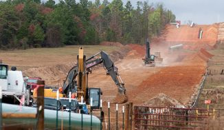** FILE ** Work has begun on the Keystone XL pipeline near Winona, Texas, but whether it will ever carry oil sands from central Canada to Gulf Coast refineries awaits a decision by President Obama. (Tyler [Texas] Morning Telegraph via Associated Press)