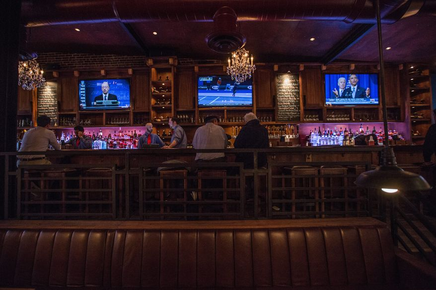 The long bar at Hawk 'n' Dove is still along the east wall of the gathering place on Pennsylvania Avenue Southeast, but it has been polished up along with the rest of the place during a 15-month renovation by the new owners. (Andrew S. Geraci/The Washington Times)