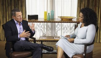 Cyclist Lance Armstrong is interviewed by talk-show host Oprah Winfrey on Monday, Jan. 13, 2013, in Austin, Texas. (AP Photo/Harpo Studios Inc., George Burns)