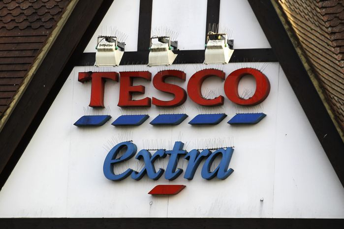 """** FILE ** Tesco, the United Kingdom's biggest supermarket chain, took out full-page newspaper ads on Thursday, Jan. 17, 2013, to apologize for an unwanted ingredient in some of its hamburger: horsemeat. The contrite grocer told customers that """"we and our supplier have let you down and we apologize."""" (AP Photo/Sang Tan)"""