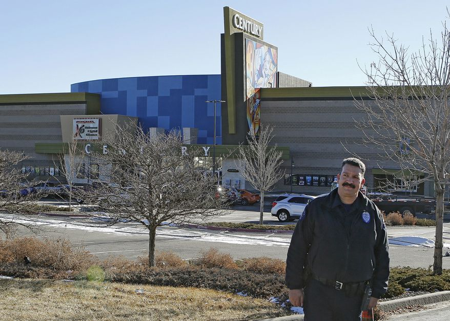 Aurora, Colo., police Officer Mike Moore guards the entrance to the Century theater on Thursday, Jan. 17, 2013. The Colorado movie complex, where a gunman killed 12 people and wounded dozens of others, reopens Thursday with a private ceremony for victims, first responders and officials. (AP Photo/Ed Andrieski)