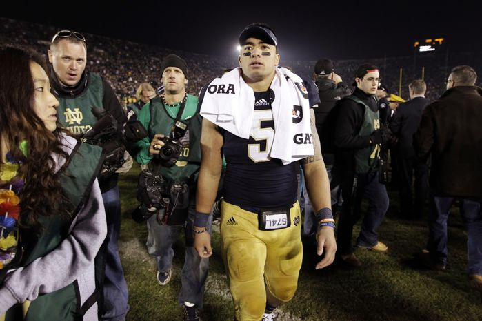 FILE - In this Nov. 17, 2012, file photo, Notre Dame linebacker Manti Te'o walks off the field following an NCAA college football game against Wake Forest in South Bend, Ind. A story that Te'o's girlfriend had died of leukemia _ a loss he said inspired him to help lead the Irish to the BCS championship game _ was dismissed by the university Wednesday, Jan. 16, 2013, as a hoax perpetrated against the linebacker. (AP Photo/Michael Conroy, File)