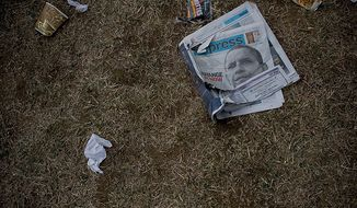 Trash litters the ground after the crowds being to dissipate from around the Washington Monument on inauguration day on the National Mall in Washington D.C., Tuesday, Jan. 20, 2009.  (Allison Shelley / The Washington Times)