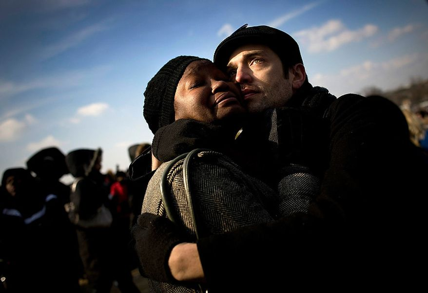 "Married coule Joe Savage and Devan Southerland of Baltimore embrace after the swearing in of President Barack Obama on inauguration day on the National Mall in Washington D.C., Tuesday, Jan. 20, 2009.  ""I never ever thought we'd see this day,"" said Savage. (Allison Shelley / The Washington Times)"