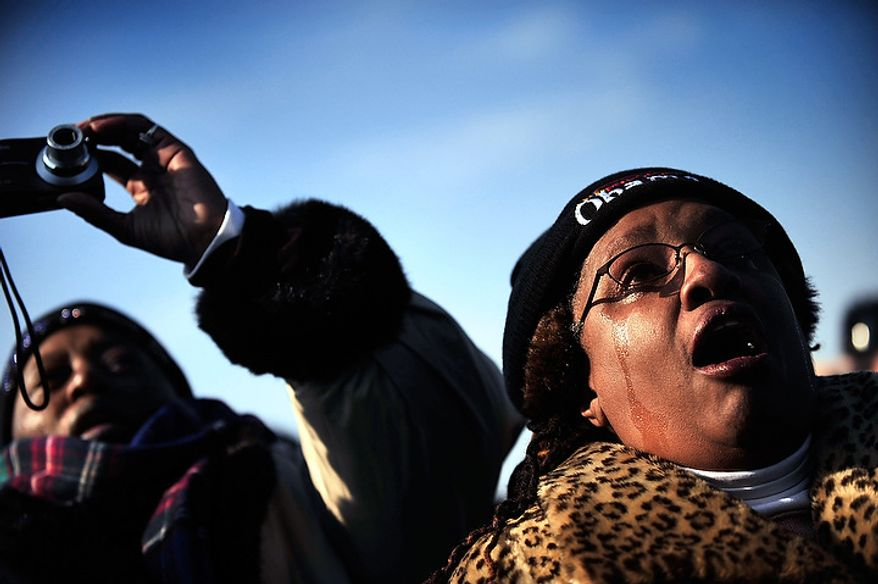 Sharon Schneider, right, of Decatur, Georgia, and friend Patricia Brown, left, of Atlanta, Georgia, react as President Barack Obama is sworn in on inauguration day on the National Mall in Washington D.C., Tuesday, Jan. 20, 2009.  (Allison Shelley / The Washington Times)