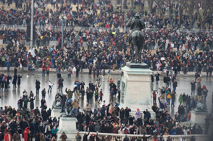 ** FILE ** Some of the assembled onlookers celebrated President Barack Obama's inauguration as the 44th President of the United States by taking to the ice on the U.S. Capitol Reflecting Pool in Washington, D.C., Tuesday, Jan. 20, 2009. (J.M. Eddins Jr. / The Washington Times)
