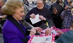 "Pauline Friedman Phillips, known to millions of newspaper readers as Dear Abby columnist Abigail van Buren, signs autographs for some of the dozens of her fans after the dedication of a ""Dear Abby"" star on the Hollywood Walk of Fame in Los Angeles in 2001. (AP Photo/Reed Saxon)"