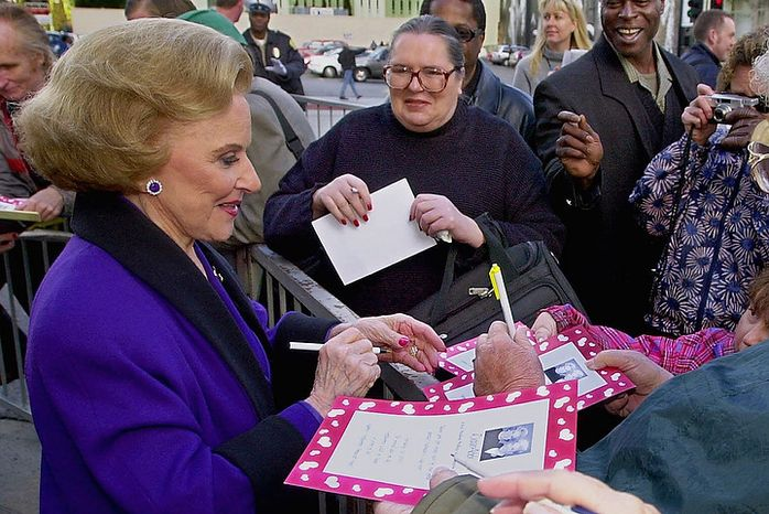 """Pauline Friedman Phillips, known to millions of newspaper readers as Dear Abby columnist Abigail van Buren, signs autographs for some of the dozens of her fans after the dedication of a """"Dear Abby"""" star on the Hollywood Walk of Fame in Los Angeles in 2001. (AP Photo/Reed Saxon)"""