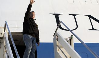 U.S. Defense Secretary Leon Panetta waves goodbye as he departs Rome en route to Vincenza, Italy on Thursday, Jan. 17, 2013. (AP Photo/Jacquelyn Martin)
