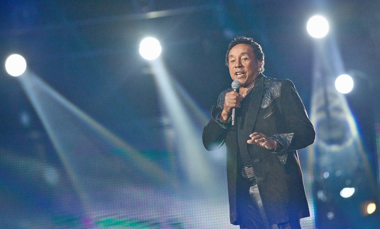 **FILE** Smokey Robinson performs Oct. 8, 2011, during the Michael Forever the Tribute Concert at the Millennium Stadium in Cardiff, Wales. (Associated Press)