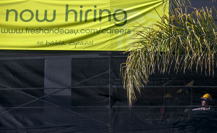 "A ""now hiring"" banner hangs above a construction site for a future Fresh & Easy supermarket in Los Angeles on Friday, Dec. 7, 2012. (AP Photo/Damian Dovarganes)"
