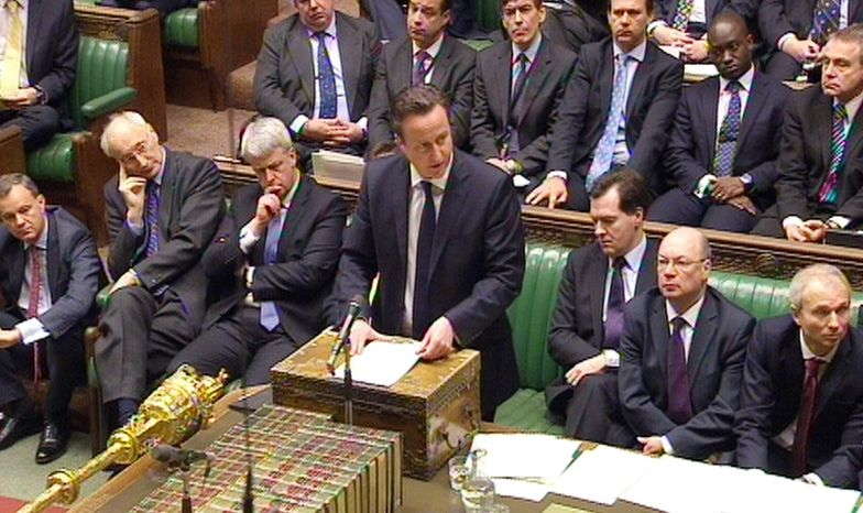 Britain Prime Minister David Cameron (center) speaks Jan. 18, 2013, to the House of Commons in London about the hostage situation in Algeria in this image taken from television. (Associated Press)