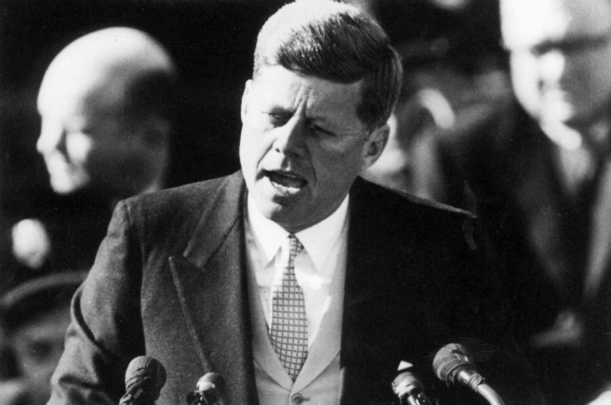 ** FILE ** President John F. Kennedy delivers his inaugural address after taking the oath of office at the Capitol in Washington on Jan. 20, 1961. (Associated Press)