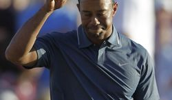 Tiger Woods from the U.S. reacts to the fans after he finished the second round of Abu Dhabi Golf Championship in Abu Dhabi, United Arab Emirates, Friday, Jan. 18, 2013. (AP Photo/Kamran Jebreili)