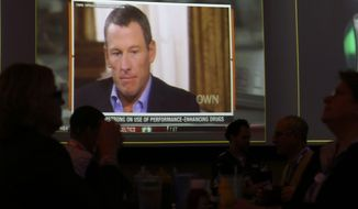 A video screen at a hotel restaurant in Grapevine, Texas, Friday, Jan. 18, 2013, shows a replay telecast of a segment of Lance Armstrong being interviewed by Oprah Winfrey. The second part of the interview airs on Friday night. (AP Photo/LM Otero)