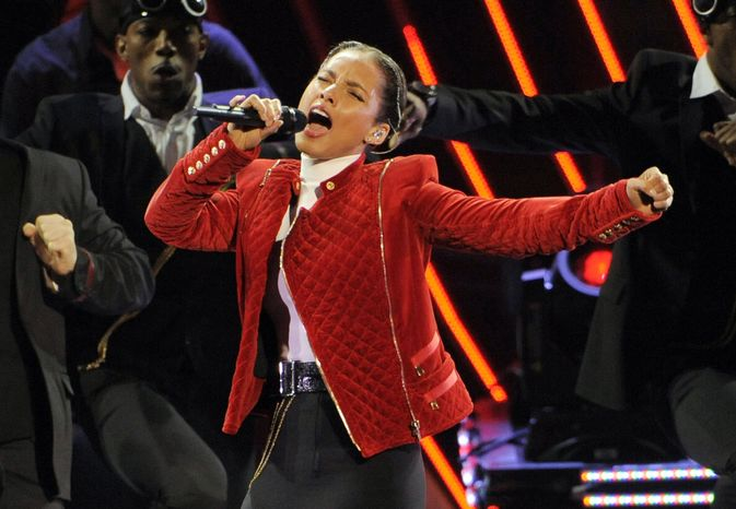 **FILE** Alicia Keys performs Jan. 9, 2013, at the People's Choice Awards in Los Angeles. (Associated Press/Invision)