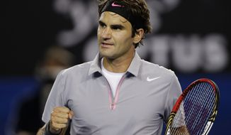 Switzerland's Roger Federer reacts during his third round match against Australia's Bernard Tomic at the Australian Open tennis championship in Melbourne, Australia, Saturday, Jan. 19, 2013. (AP Photo/Andy Wong)