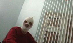 In this video grab provided by RenTV via APTN, artistic director of the Bolshoi ballet Sergei Filin gestures in a hospital in Moscow, Friday, Jan. 18, 2013, where he is being treated. Filin, a 42-year-old former Bolshoi star, said a man threw the acid into his face late Thursday near the gate of his apartment building in central Moscow.  (AP Photo/RenTV) TV OUT