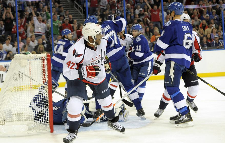 Washington Capitals right wing Joel Ward (42) celebrates his goal during the first period of an NHL hockey game against the Tampa Bay Lightning Saturday, Jan. 19, 2013, in Tampa, Fla. (AP Photo/Brian Blanco)