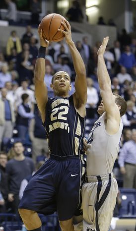 George Washington guard Joe McDonald (22) in action against Xavier in an NCAA college basketball game, Sa