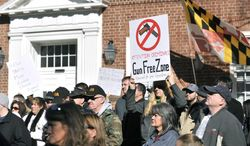 Protesters hold up signs during a protest against Maryland Gov. Martin O'Malley's new gun control legislation at Lawyers Mall in Annapolis, Saturday, Jan. 19, 2013. Rallies are being held by gun rights advocates four days after President Barack Obama unveiled a sweeping plan to curb gun violence. (AP Photo/Capital Gazette, Matthew Cole)