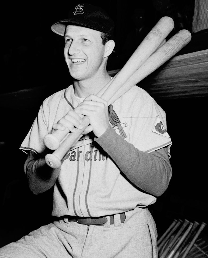 FILE - In this Feb. 25, 1952, file photo, St. Loius Cardinals; Stan Musial poses with his bats on his shoulder as he put on his St. Louis Cardinal uniform for the first time this season at spring training baseball in St. Petersburg, Fla. Musial, one of baseball's greatest hitters and a Hall of Famer with the St. Louis Cardinals for more than two decades, died Saturday, Jan 19, 2013, the Cardinals announced. He was 92. (AP Photo/Stroup, File)