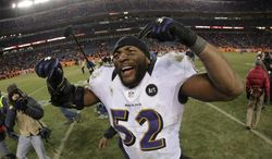 In a photo taken with a fisheye lens, Baltimore Ravens inside linebacker Ray Lewis celebrates after the Ravens beat the Denver Broncos 38-35 in overtime of an AFC divisional playoff NFL football game, Saturday, Jan. 12, 2013, in Denver. (AP Photo/Charlie Riedel)
