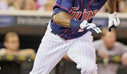 Minnesota Twins center fielder Denard Span (2) plays against the Chicago White Sox during a baseball game, Monday, July 30, 2012, in Minneapolis. (AP Photo/Paul Battaglia)