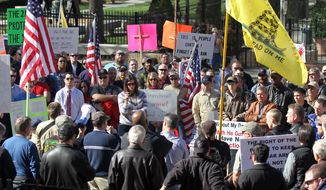 People gather during a Guns Across America rally on the steps of the Georgia Capitol on Saturday, Jan. 19, 2013, in Atlanta. Thousands of gun advocates gathered peacefully at state capitals across the U.S. to rally against stricter limits on firearms. (AP Photo/Atlanta Journal-Constitution, Phil Skinner)