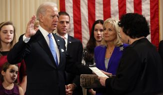 Vice President Joseph R. Biden takes the oath of office, administered by Supreme Court Associate Justice Sonia Sotomayor at the residence of the vice president at the U.S. Naval Observatory as Jill Biden looks on, on Sunday, Jan. 20, 2012, in Washington. (AP Photo/New York Times, Josh Haner, Pool)