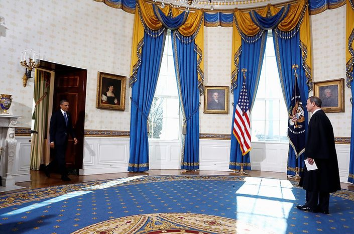President Barack Obama arrives to be officially sworn-in by Chief Justice John Roberts in the Blue Room of the White House during the 57th Presidential Inauguration in Washington, Sunday, Jan. 20, 2013. (AP Photo/Larry Downing, Pool)