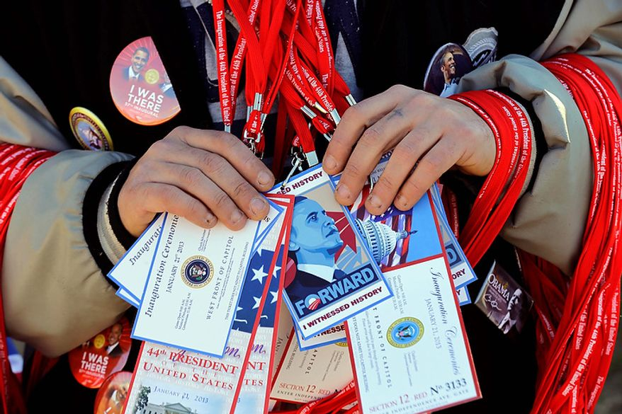 A vendor holds items for sale on the National Mall with the U.S. Capitol prepared for the ceremonial swearing-in of President Barack Obama, the 57th Presidential Inaugural, Sunday, Jan. 20, 2013 in Washington. (AP Photo/Alex Brandon)
