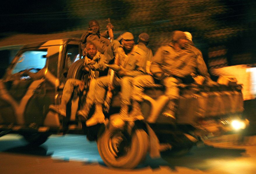 Malian soldiers are jubilant as they return to Niono, Mali, from Diabaly, some 300 miles north of the capital, Bamako, on Saturday, Jan. 19, 2013. (AP Photo/Jerome Delay)
