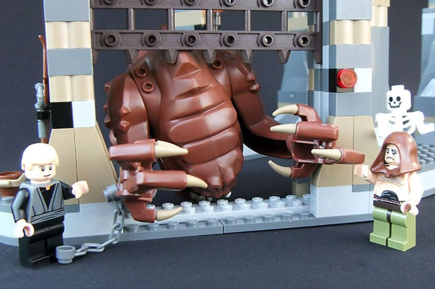 Luke Skywalker handles a Rancor while his keeper Malakili looks on in the Lego Star Wars Rancor Pit set.  (Photograph by Joseph Szadkowski / The Washington Times)