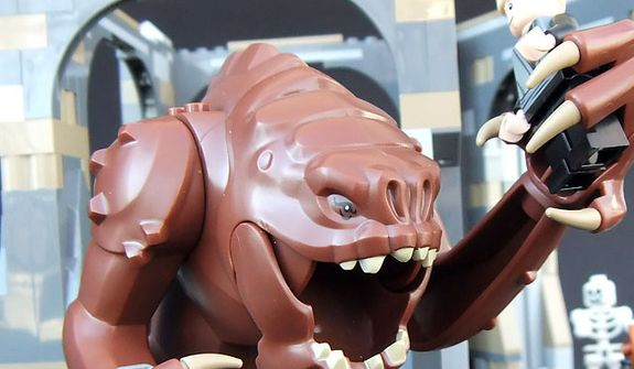 A smiling Rancor gets ready to devour Luke Skywalker in he Lego Star Wars Rancor Pit set. (Photograph by Joseph Szadkowski / The Washington Times)