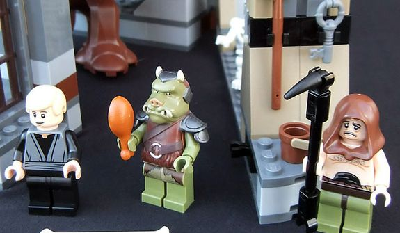 The Lego Star Wars Rancor Pit set includes the minifigures Luke Skywalker, a Gamorrean guard and Malakili. (Joseph Szadkowski/The Washington Times)