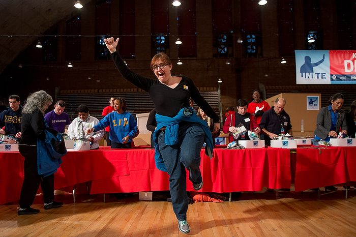 Sadi Dingfelder of Washington, D.C. jumps for joy after putting together a service package for members of the armed services abroad during the National Day of Service at the D.C. Armory, Washington, D.C., Saturday, January 19, 2013. Non-profit groups are running hundreds of service projects for the Martin Luther King Jr. weekend. (Andrew Harnik/The Washington Times)