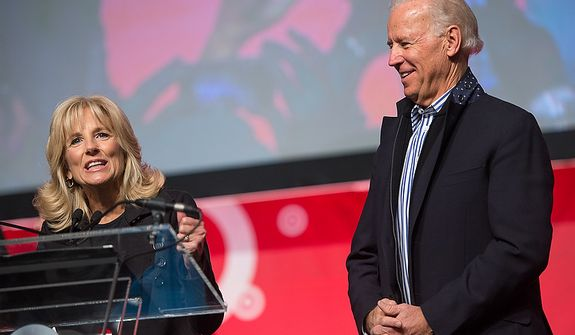 Vice President Joseph Biden and his wife Jill Biden take the stage to speak to volunteers who put together service packages for members of the armed services abroad during the National Day of Service at the D.C. Armory, Washington, D.C., Saturday, January 19, 2013. Non-profit groups are running hundreds of service projects for the Martin Luther King Jr. weekend. (Andrew Harnik/The Washington Times)