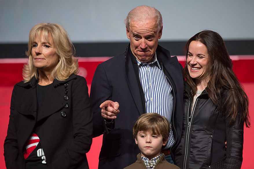 Vice President Joseph Biden, his wife Jill Biden, left, and their family take the stage to speak to volunteers who put together service packages for members of the armed services abroad during the National Day of Service at the D.C. Armory, Washington, D.C., Saturday, January 19, 2013. Non-profit groups are running hundreds of service projects for the Martin Luther King Jr. weekend. (Andrew Harnik/The Washington Times)
