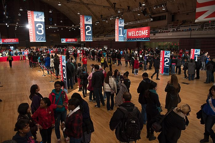 Hundreds of volunteers line up to put together service packages for members of the armed services abroad during the National Day of Service at the D.C. Armory, Washington, D.C., Saturday, January 19, 2013. Non-profit groups are running hundreds of service projects for the Martin Luther King Jr. weekend. (Andrew Harnik/The Washington Times)