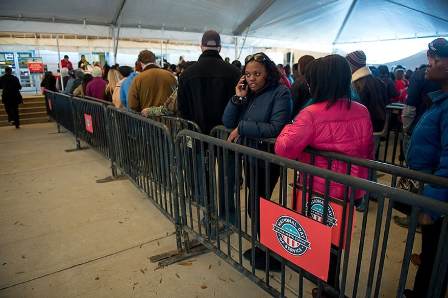 Volunteers wait in line to sign in before putting together service packages for members of the armed services abroad during the National Day of Service at the D.C. Armory, Washington, D.C., Saturday, January 19, 2013. Non-profit groups are running hundreds of service projects for the Martin Luther King Jr. weekend. (Andrew Harnik/The Washington Times)