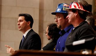 ** FILE ** Wisconsin Gov. Scott Walker, delivers a State of the State address in Madison. (Associated Press)