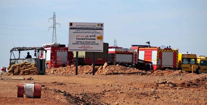Rescue vehicles swarm the gas plant where al Qaeda-linked terrorists held hundreds of people hostage. An Algerian military assault Saturday ended with the deaths of at least 23 hostages, including an American, and 32 heavily armed kidnappers. (Associated Press)