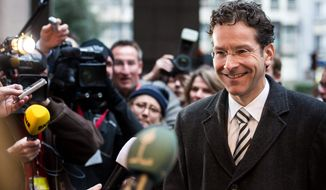 "Dutch Finance Minister Jeroen Dijsselbloem, the new head of the eurozone's finance ministers, said in Brussels, ""Restoring further trust in the euro and building economic prospectives for the countries, that's the main task at hand."" (Associated Press)"