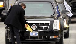 President Obama's armored limousine is polished up with a new license plate after his arrival at the U.S. Capitol for his inauguration on Monday, Jan. 21, 2013. (Associated Press)